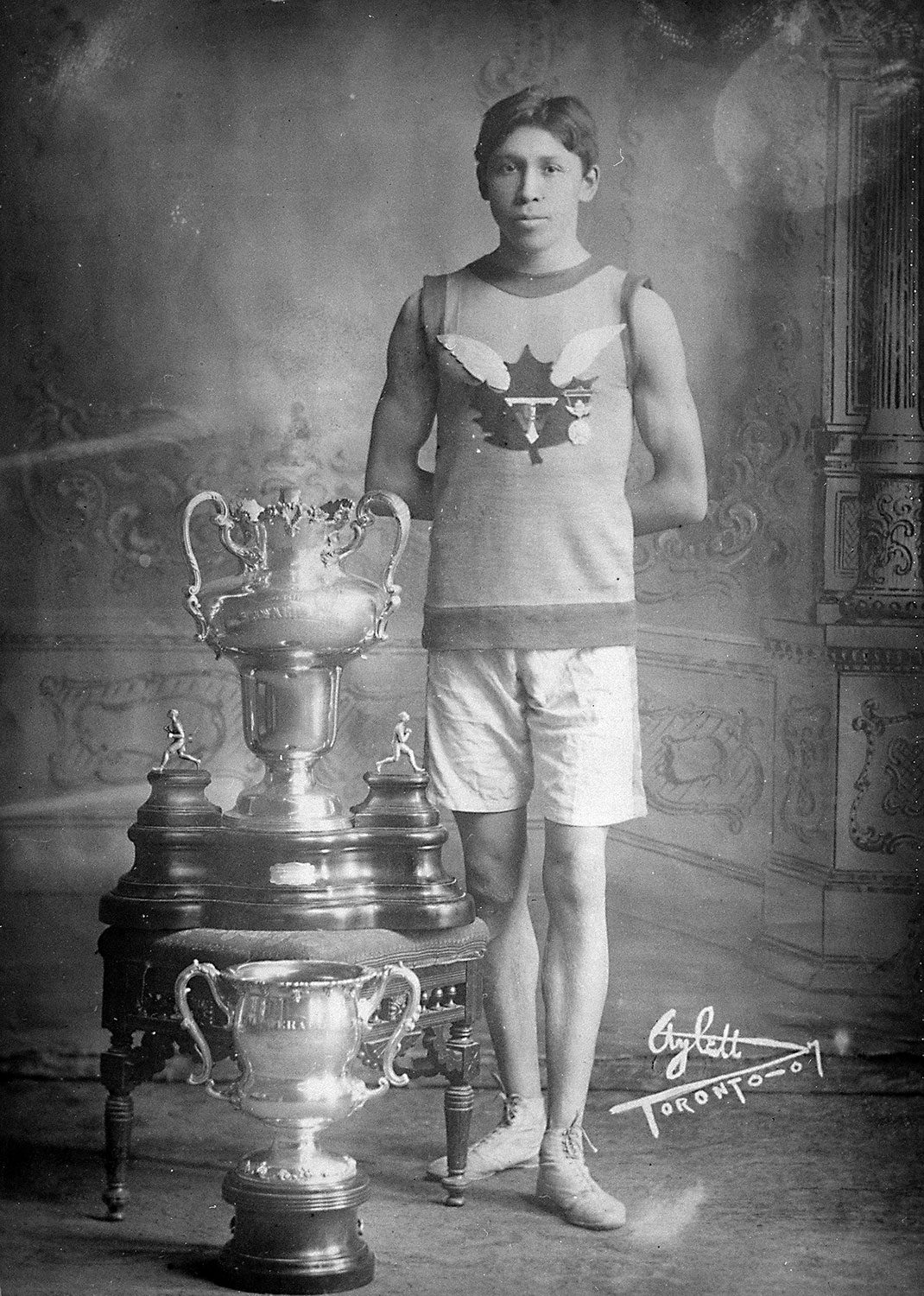 Tom Longboat with running trophies (April 22, 1907). Photo courtesy of Library and Archives Canada.