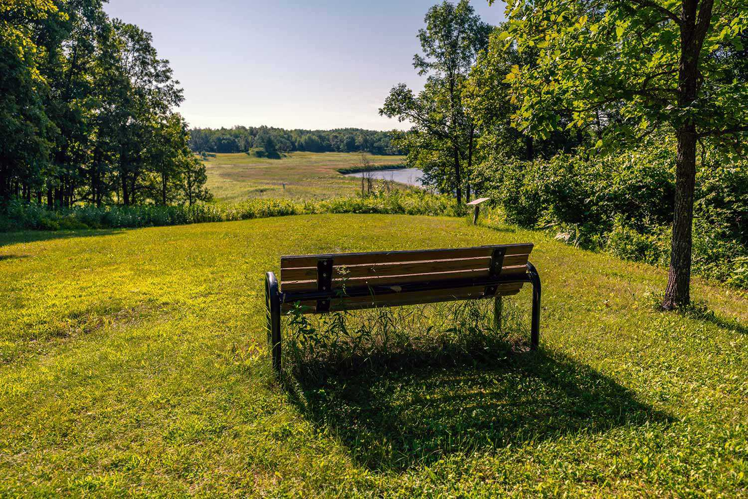 This bench overlooks the river and burial mounds (Photo: Chris McEvoy, Rusty Anchor Productions)