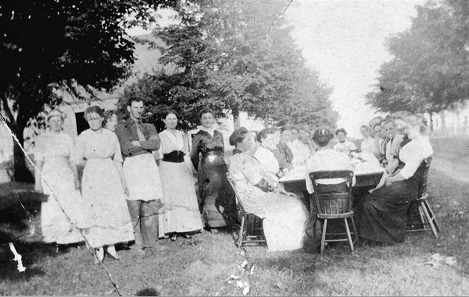 Feast after a quilting bee at Mrs. Burts, Erin Township, 1915. (Ph 10312, Wellington County Museum and Archives)
